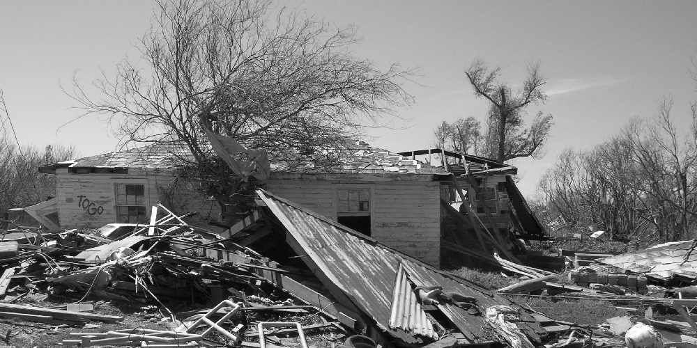 Banner image of house damaged by Katrina
